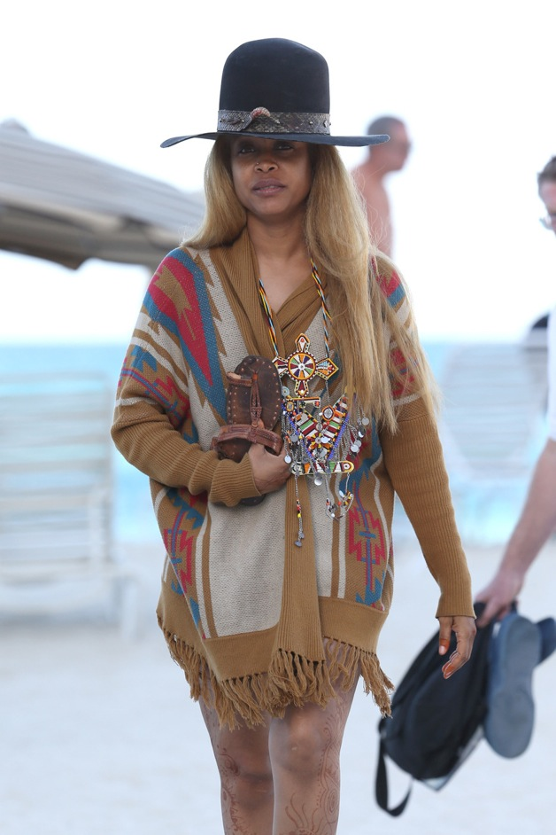Erykah Badu shows off her bikini body and henna tattoos on the beach before changing into a Native American inspired outfit on Miami Beach