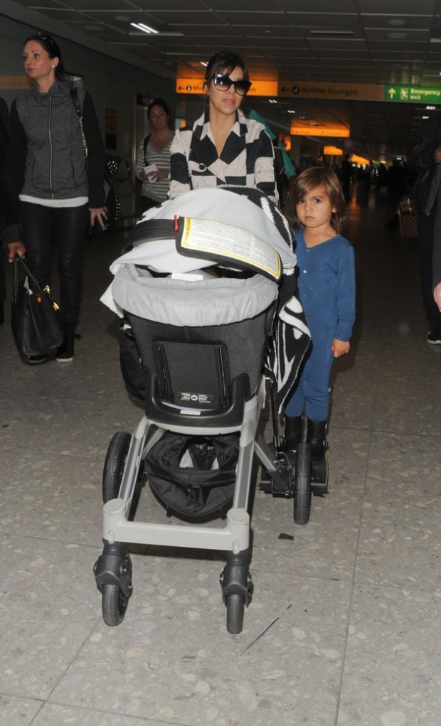 Kourtney Kardashian and Mason Dash Disick seen at Heathrow Airport in London