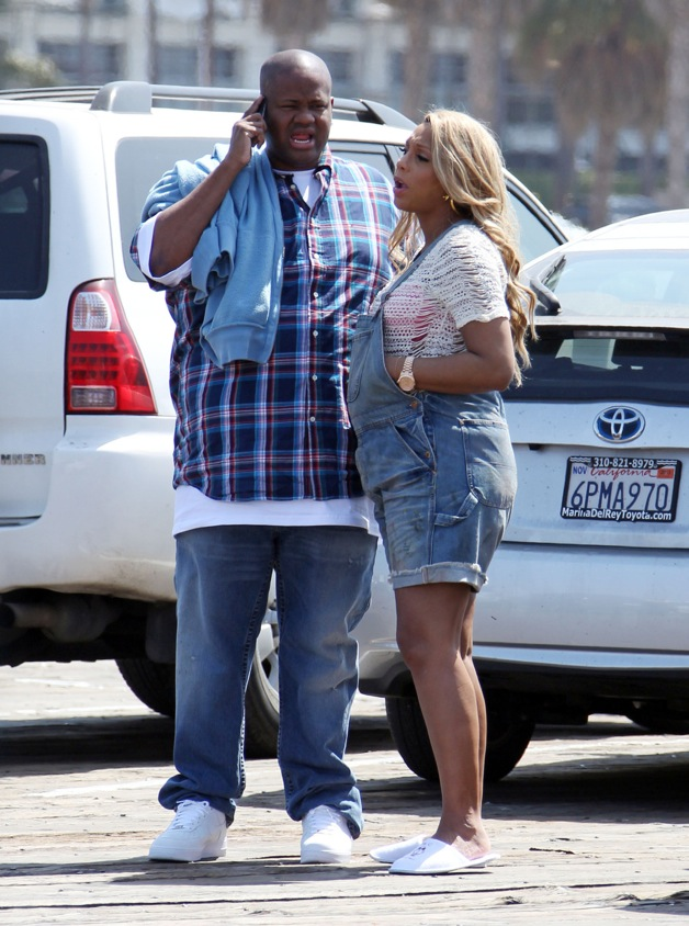 **EXCLUSIVE** Tamar Braxton shows off her growing baby bump in overall shorts while filming her new music video in Los Angeles