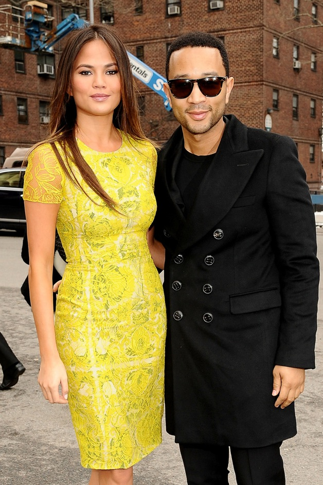 Chrissy Teigen and John Legend attend the Badgley Mischka show during New York Fashion Week