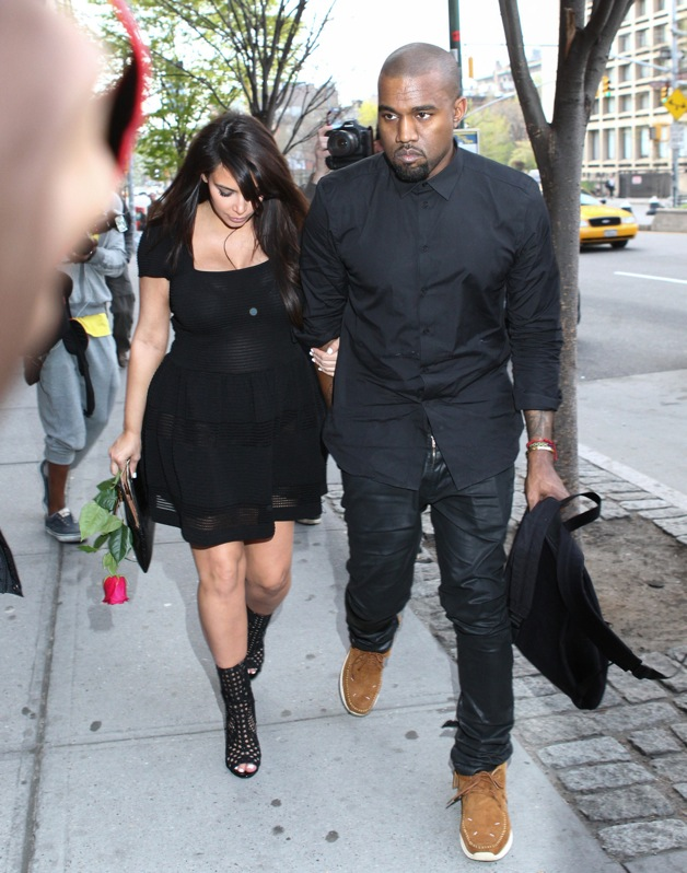 Kim Kardashian and Kanye West seen leaving office building while Kim is holding a red rose in New York City