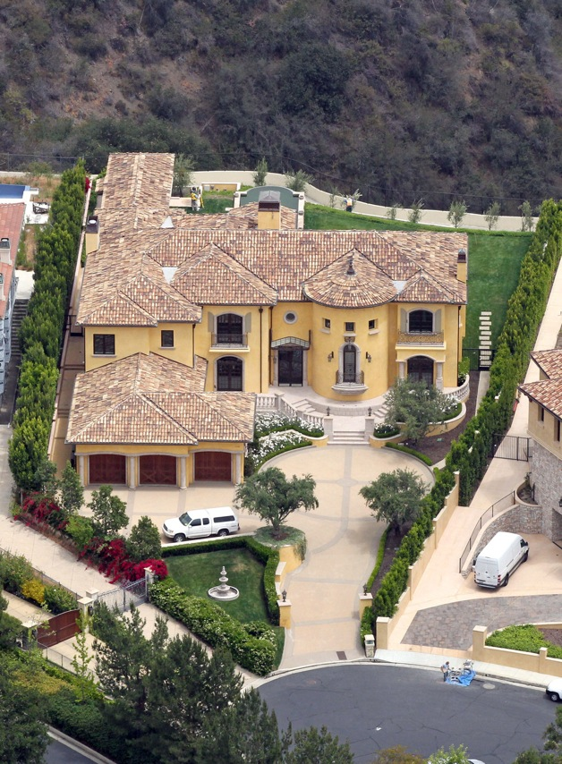 Kim Kardashian and Kanye West have reportedly splashed†out nearly $11 million for this Mediterranean style mansion located in a guard gated community near Bel Air