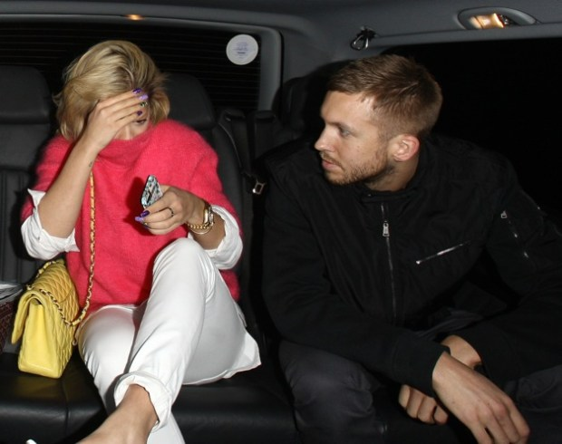 A camera shy Rita Ora and Calvin Harris pictured leaving the Electric Cinema in London