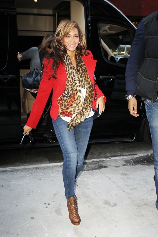 Mom-to-be, Beyonce, is seen entering an office building wearing a red pea coat and designer boots in New York