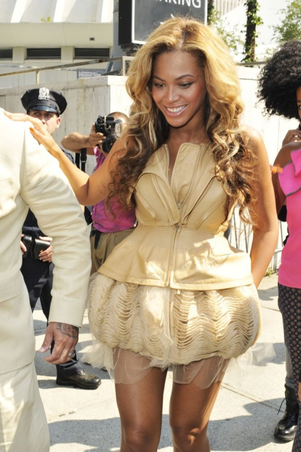 Superstar and soon-to-be mom Beyonce looking radiant in a gold glittery dress as she leaves the Rodarte fashion show in NYC