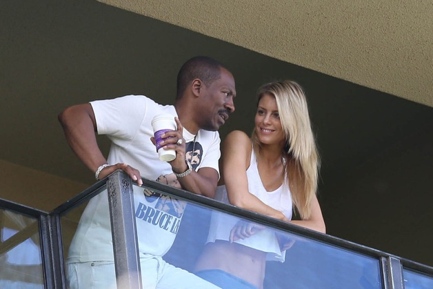 BALCONY LOVERS! Eddie Murphy, wearing a Bruce Lee t-shirt, sips on a hot coffee while on his hotel balcony with girlfriend Paige Butcher in Hawaii