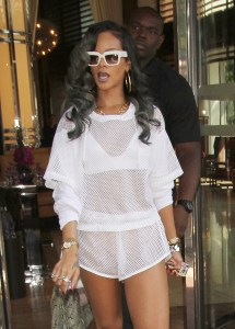 Rihanna seen wearing a sheer all-white jersey outfit while leaving her London hotel