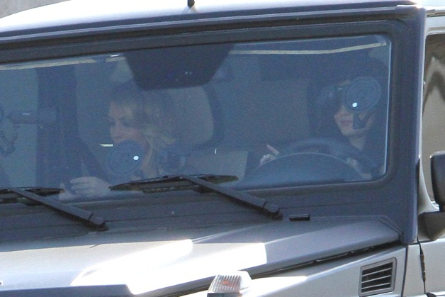 Kim Kardashian and Kylie Jenner arrive to film their reality TV show at Dash in West Hollywood