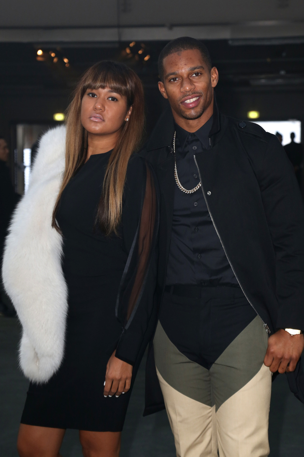 "Victor Cruz and Elaina Watley seen at the ""Givenchy"" fashion show during the Paris Fashion Week in Paris"