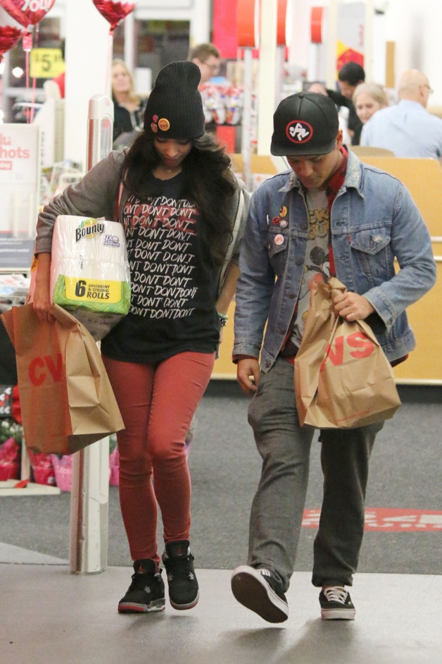 Camera shy Bruno Mars and his girlfriend Jessica Caban seen leaving a local drug store in Los Angeles