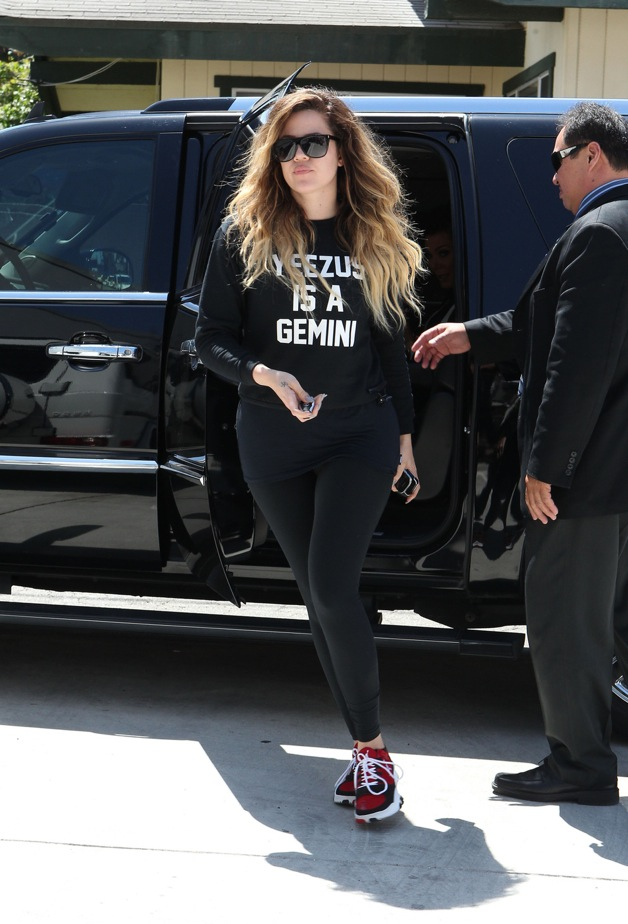 Khloe Kardashian heads to the gym wearing a Yeezus Is A Gemini Sweater in Los Angeles