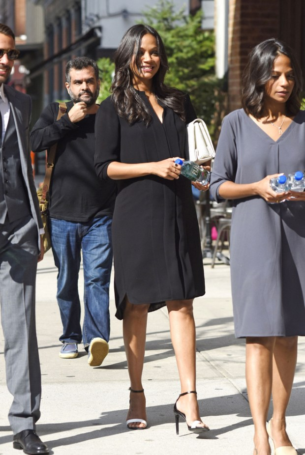 Pregnant Zoe Saldana takes photos with fans outside the Greenwich Hotel in New York City