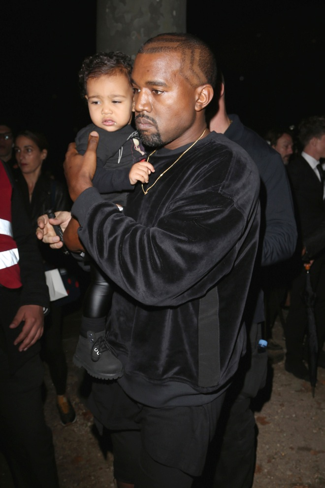 Kim Kardashian, Kanye West and daughter North seen arriving at the Balenciaga Fashion show in Paris