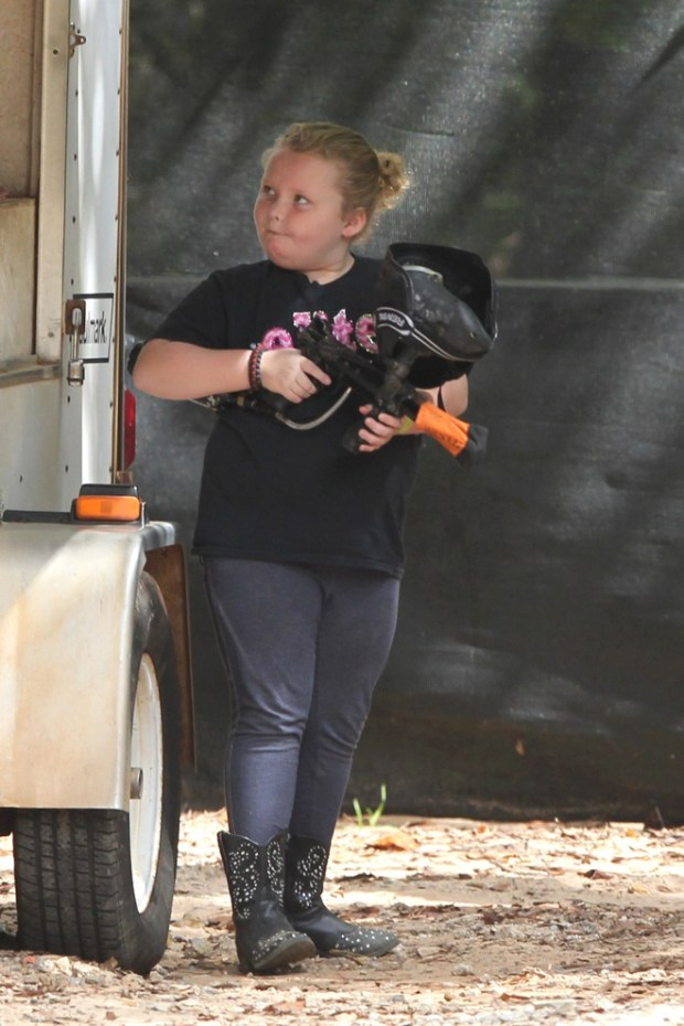 Alana 'Honey Boo Boo' Thompson gets to grips with a paintball gun on an afternoon paint-balling with her dad Sugar Bear and her sisters near their home in McIntyre, GA