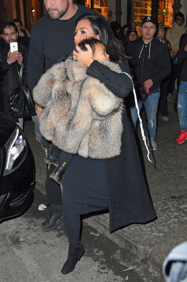 Kim Kardashian seen carrying North as she leaves 'Adidas' office in New York City