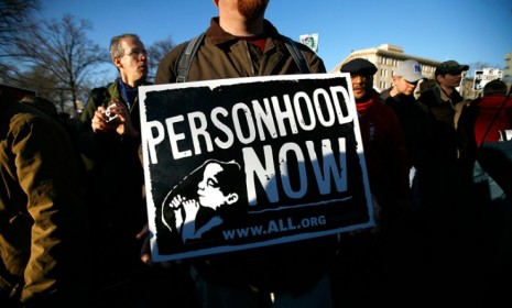 """Anti-abortion activists rally for a """"personhood"""" amendment in Mississippi. The measure would have legally redefined life as beginning at conception."""