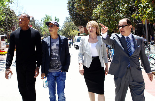 From left, Dr. Dre, Jimmy Iovine, Prof. Erica Muhl and C. L. Max Nikias, the U.S.C. president, in Los Angeles on Monday.