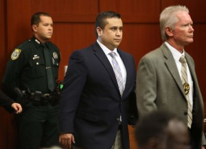George Zimmerman is escorted into the courtroom by armed Sheriffs.