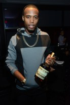 B.o.B with a Hennessy Luminous bottle