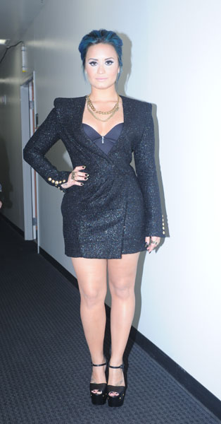 Demi's Look: Dress-Balmain, Jewelry-Bones and Feather Collective, Shoes-Giuseppe