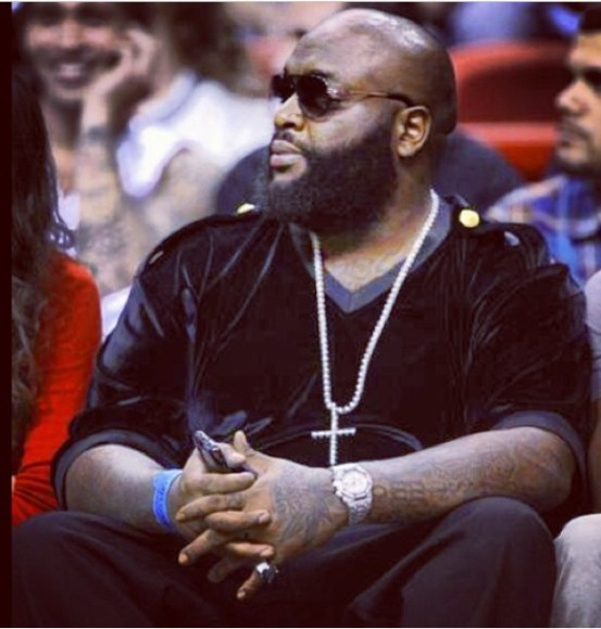 Rick Ross sitting court side in Exclusive Game