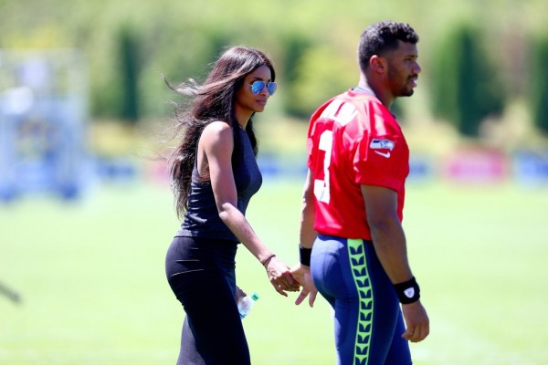 Seattle Seahawks quarterback Russell Wilson, with girlfriend, Ciara, during the first day of training camp at the Virginia Mason Athletic Center on Friday, July 31, 2015, in Renton, Wash.