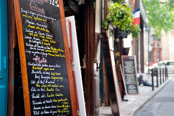a sidewalk cafe chalkboard menu