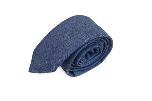 Blauwe spijker stropdas.