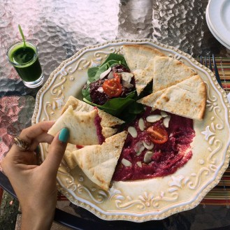 Pink Hummus with Pita and spinach salad. Added wheatgrass shot for energy boost!
