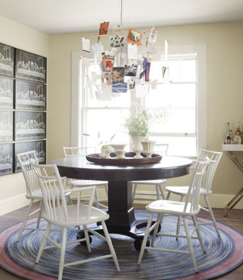 Dining room with round table and modern chandelier also maine country cottage decorating ideas for decor rh countryliving