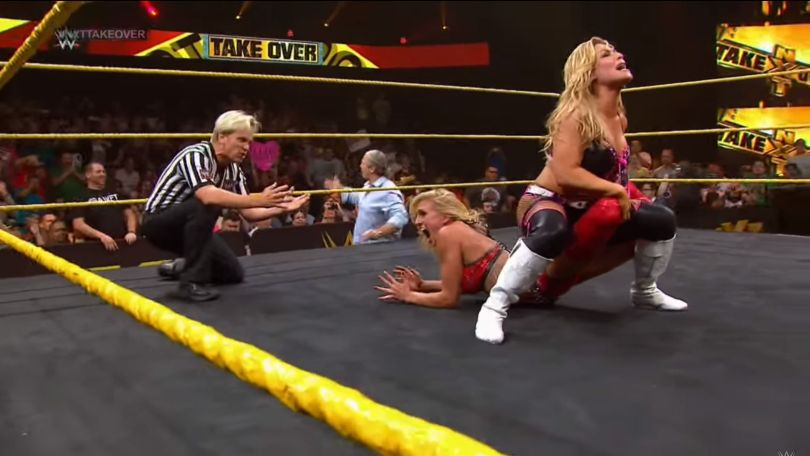 Natalya gets Charlotte in the Sharpshooter at NXT TakeOver