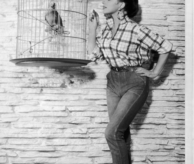 Circa  Full Length Portrait Of British Born Actor Joan Collins Feeding A