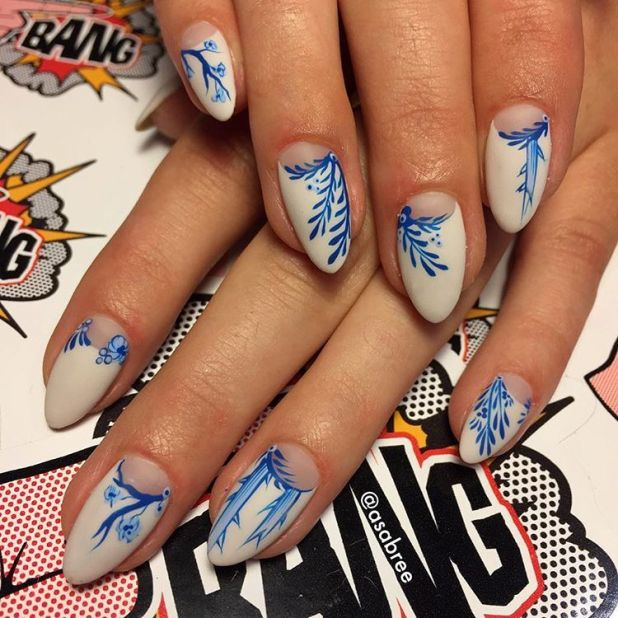 """<p>Self-proclaimed """"nail artist connoisseur""""Asa Bree Sieracki<span class=""""redactor-invisible-space"""" data-verified=""""redactor"""" data-redactor-tag=""""span"""" data-redactor-class=""""redactor-invisible-space""""> created this</span>Asian-inspired look that has us in awe. Get the lookby painting a white base,leavingyour half-moons bare. Once dry add details like bamboo shoots and cherry blossoms in royal blue. Finish will a top coat.</p><p><em data-redactor-tag=""""em"""" data-verified=""""redactor"""">Design by<span class=""""redactor-invisible-space"""" data-verified=""""redactor"""" data-redactor-tag=""""span"""" data-redactor-class=""""redactor-invisible-space""""></span><a href=""""https://www.instagram.com/p/BK9Cwj7D85e/"""" target=""""_blank"""">@asabree</a></em><em data-redactor-tag=""""em"""" data-verified=""""redactor"""">  </em></p>"""