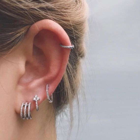 Ear Piercings Multiple Ear Piercings Inspiration For Curating Your Ear Constellation