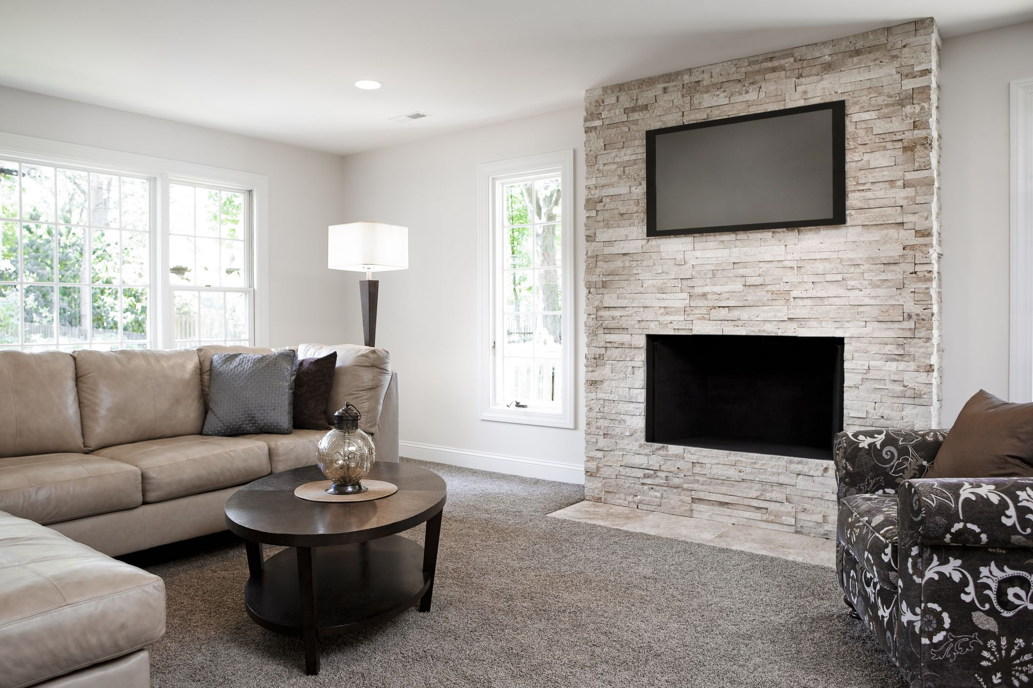 how to decorate living room with tv over fireplace lamp for stop hanging your television