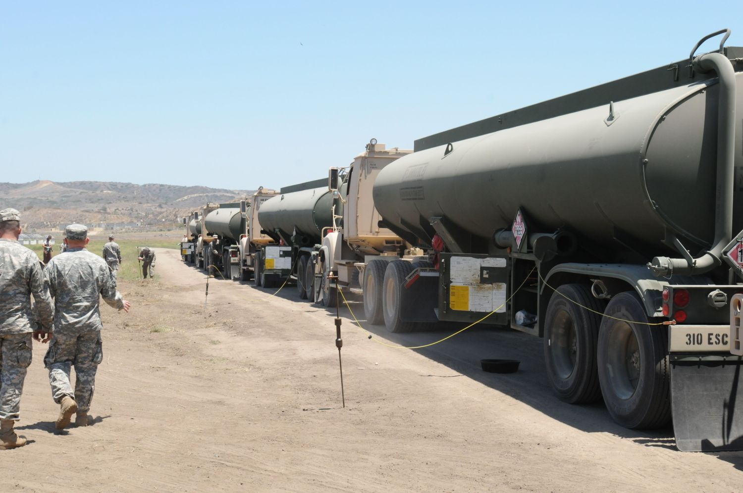 a convoy of fuel trucks stops to have their fuel cargo tested at the quartermaster liquid logistics excercise, camp pendleton, ca qllex is a joint forces exercise where 64 units at eight locations across the continental united states will deliver more than 325 million gallons of petroleum and produce 479,000 gallons of water, designed to challenge and develop the battalion's staff military decision making skills us army photo by spc thomas x croughreleased