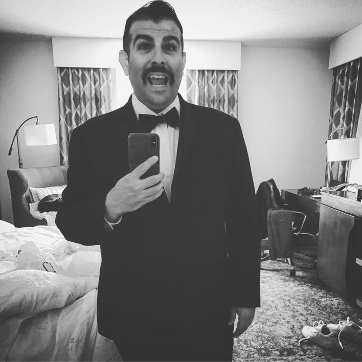 Suit, Room, Black-and-white, Formal wear, Photography, Monochrome, Monochrome photography, Businessperson, White-collar worker, Smile,