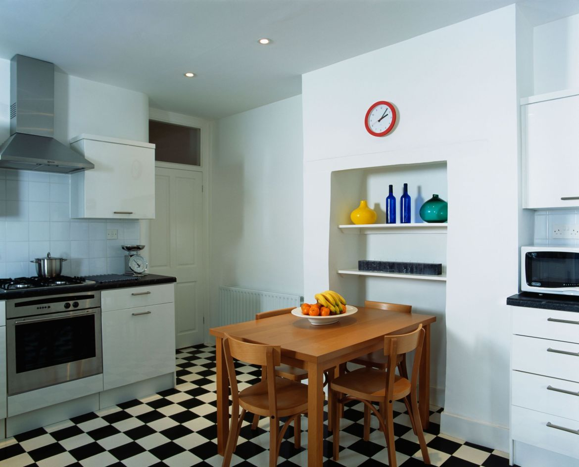 alcove ideas, simple wooden table and chairs in modern white kitchen with black white chequerboard flooring