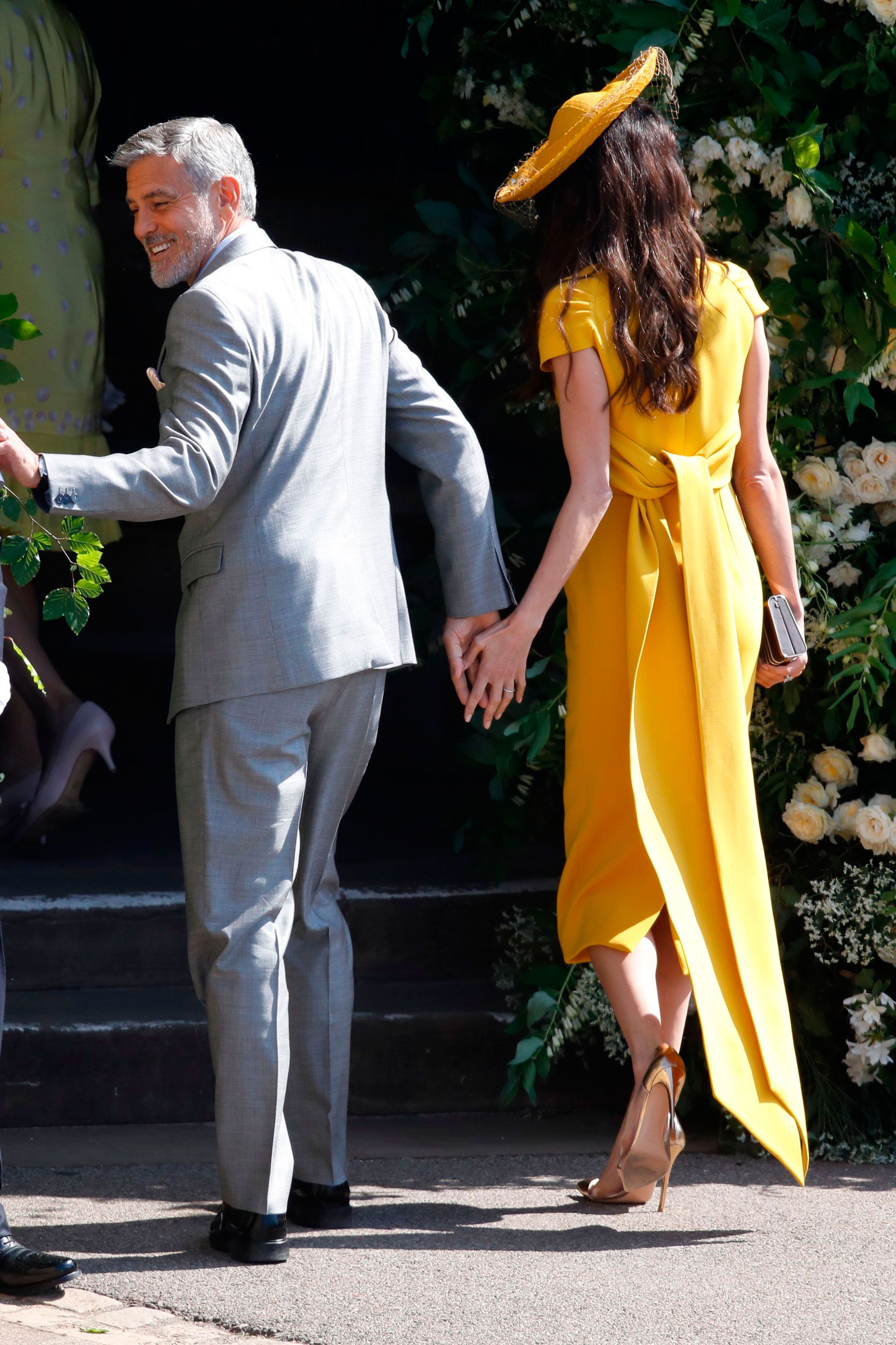 Amal Clooney looks beautiful in yellow for the royal wedding  Amal and George Clooney at the