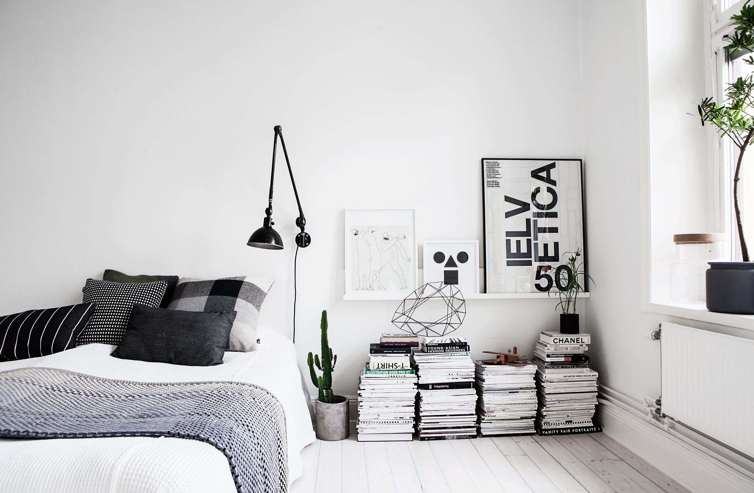A bedroom with green and black furniture, framed prints and an. 38 Minimalist Bedroom Ideas And Tips Budget Friendly Minimalism