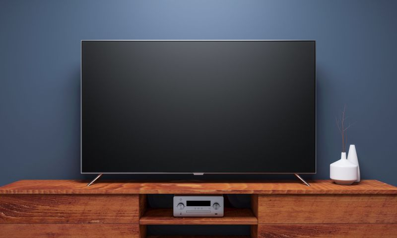 Black Smart Tv Mockup on wooden console