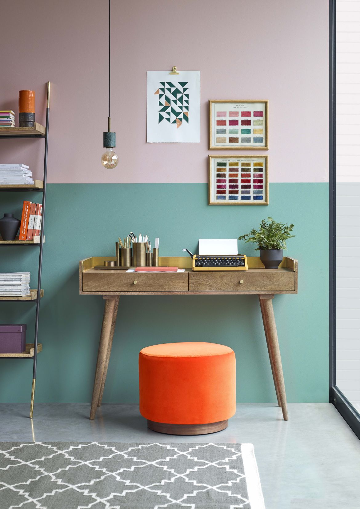 vibrant study with a desk and orange chair