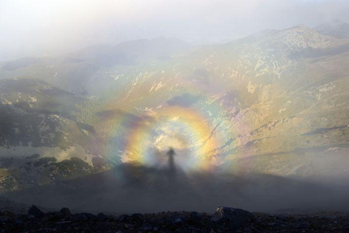 Brocken spectre, shadow of a man on top of a mountain