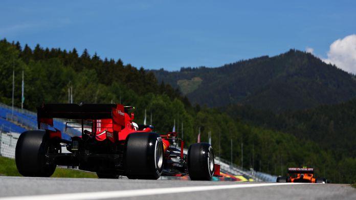 Ferrari and McLaren leaving Pit Lane