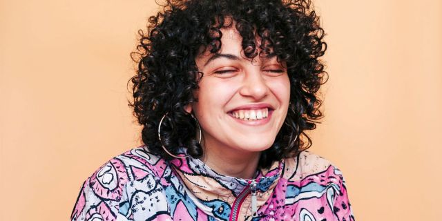 how to style curly hair - tips, tricks, and ideas for