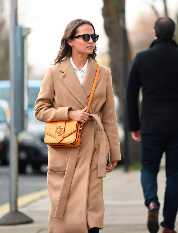 alicia vikander with the bag lv pont 9 of louis vuitton