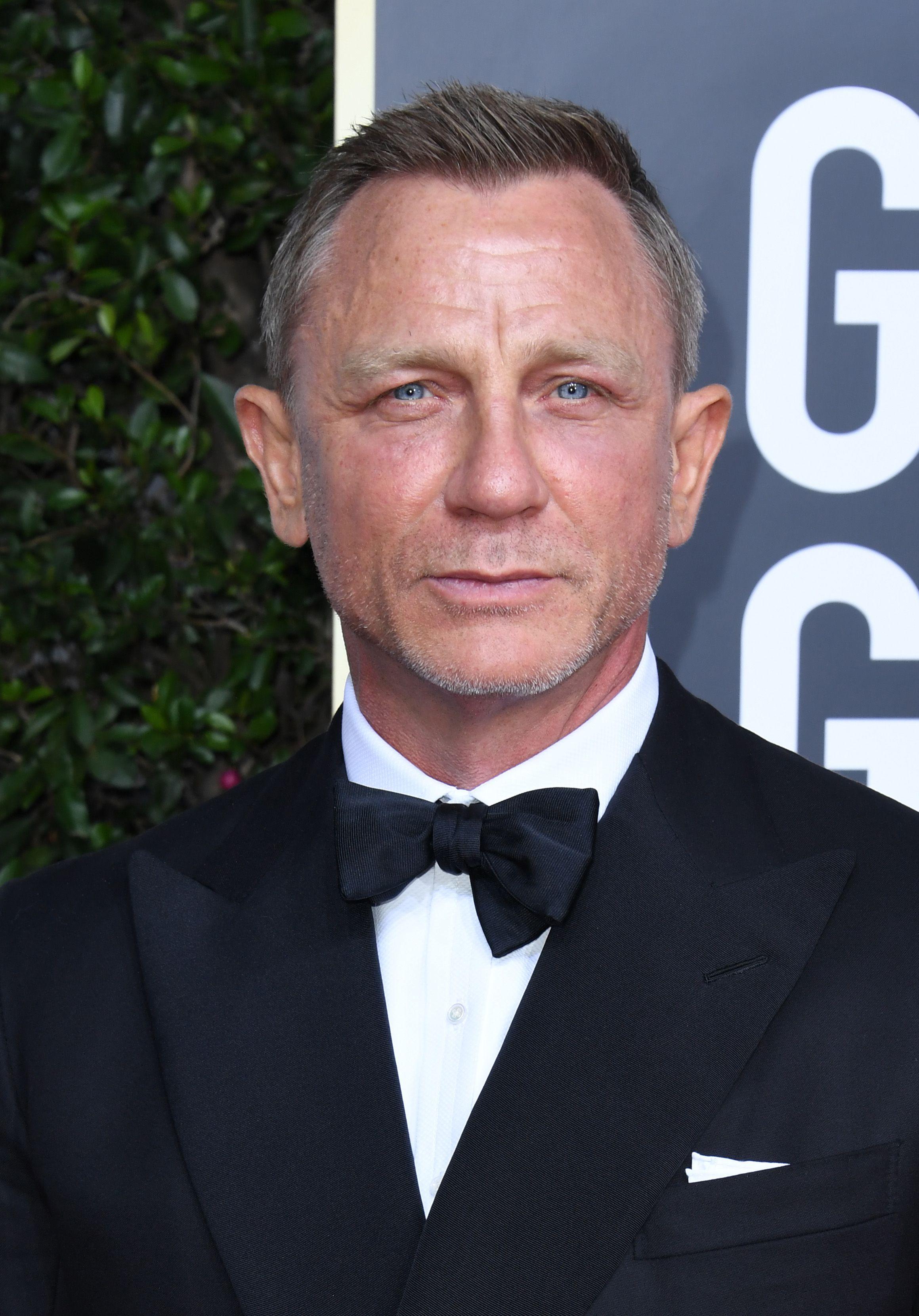 Daniel Craig, 51, hides his locks after it's revealed he