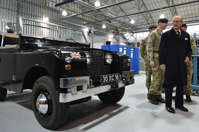 lyneham, england   march 11 prince philip, duke of edinburgh r, colonel in chief, royal electrical and mechanical engineers reme, looks at a black 1960s ceremonial land rover series 2a escort rover formally owned by the queen elizabeth the queen mother, during a visit the new home of reme to be named the prince philip barracks at mod lyneham on march 11, 2016 in lyneham, england prince philip toured the barracks visiting the technical training building to view the facility and meet soldiers and went on to visit one of the refurbished hangars on the former raf sitephoto by ben stanshall wpa poolgetty images
