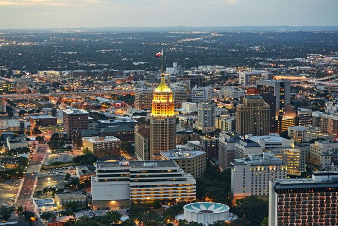 Aerial View Of Downtown San Antonio Released In The Evening With Tower Life Building