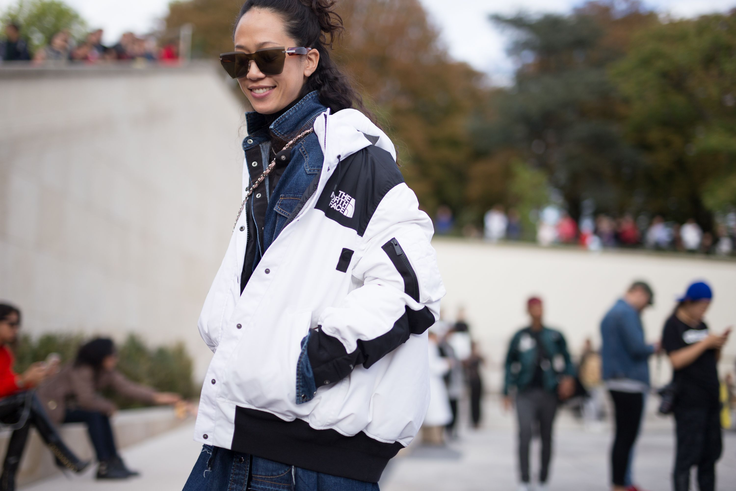 paris, france   october 02  a guest is seen attending hermes during paris fashion week wearing the north face on october 2, 2017 in paris, france  photo by matthew sperzelgetty images